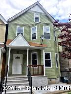 brand new vinyl siding, adorable porch and tons of windows!