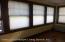 Plenty of Windows in Sunroom for natural lighting