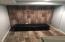 Bonus seating area in basement. Great tile work!