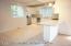Kitchen w/ SS Appliances, Granite Counter Tops, Subway Tile Backsplash, Island.