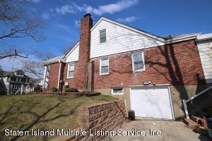 garage is street level to the side street of edison..basement is also street level...the basement has a 3/4 bath, breakfast area,family rm,heated garage..the house is solid brick