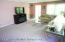 Living Dining Room Combo-Currently Used as Just Living Room. Hardwod Floors Under Carpeting