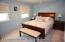 Master Bedroom w/ Double Closets (Hardwood Floors Under Carpeting).