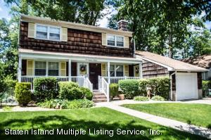 CENTER HALL COLONIAL ON A BEAUTIFUL TREE LINED STREET