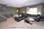 19 ft wide formal livinr room into the dining roon area