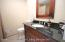 the main bath is new with granite counters/shower/bathtub