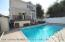 beautiful in-ground pool surrounded by pavers