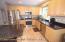 upgraded EIK w/ SS appliances, granite countertops & tiled backsplash