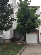 Well Kept two bedroom end unit on tree lined one way street