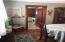 Formal dining room original chestnut moldings and doors