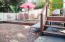 EASY LIVING YARD ...EATING AREA WITH BBQ GAS LINE HOOKUP