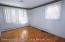 LARGE FORMAL LIVING RM W/ BASEBOARD HEAT THRU-OUT & HARDWOOD FLRS