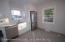 Gorgeous White Eat-in Kitchen with brand new stainless steel appliances and quartz countertops!