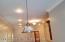 Modern light fixtures complement the decor