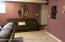 Finished Basement with View to Separate Entrance