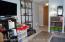 Family room with 1/2 bath, coat closet and large storage closet