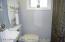 Half bath on second floor off of kitchen