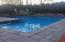 Custom in ground heated salt water pool with water fall