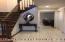 Enter into ceramic foyer thru double fiberglass front doors