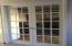 French Doors from entry foyer to formal Living Room