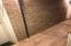 exposed brick and brand new wood tiles in halls