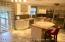 Kitchen with granite counter tops & stainless steel appliances. Radiant heating under all tiles