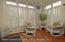 Sunroom with transient windows and custom shutters.