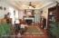 Formal Living Room w/ Fireplace, Hardwood Floors, & Tray Ceiling