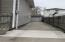 Extra long carport leading to 1.5 car garage