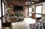 Rustic family room with marble floors, wood burning fireplace looks on to court yard and rear yard