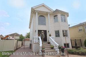 Note: custom marble chip brick front + granite steps & railings