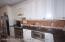 Custom solid wood cabinets + granite counters.