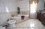 Fully tiled w/bidit plus Versage Signature tile, Jacuzzi bath & sep/shower.