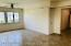 Bright and sunny spacious living room in one bedroom apartment