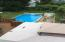Above ground pool with multi level decks off the kitchen
