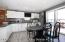 true eat in kitchen with breakfast bar with seating for 5 stools plus a table.