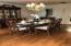 Large Formal Dining Room with stained wood floors.