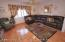 Formal Living room in the main house...there are 3 family rm/living rooms in total in this home