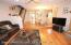 the main section holds a Formal Living room with a wood burning fireplace,Formal Dining Rm, EIK with a door to the deck & yard, half bath, hardwood floors
