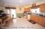 Main Eat in kitchen with sliders to deck & staircase to yard..oak cabinets , appliances stay