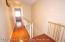 The hallway is brigth, new Flooring is up on the Sleeping floor