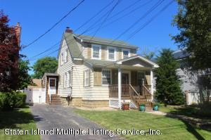 Beautiful Colonial in a perfect location situated on a 50 x 161 property with endless possibilities! Huge driveway for off street parking.