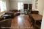 Large formal living room with hardwood floors