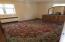 Large master bedroom with hardwood floors