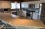 Updated kitchen with SS appliances and Corian counter tops and Island