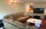 Family room with SGD to yard and spiral staircase to kitchen with wet bar.