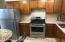 Apartment kitchen with SS appliances