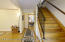 Foyer entrance. Living room to the left, kitchen straight ahead and wide staircase with wrought iron banister.