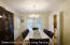 Spacious Dining Room with French doors to upper Trex deck. Easy access to kitchen as well.