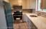 Updated Kitchen stainless steel appliances, Granite counter top, ceramic tile floors